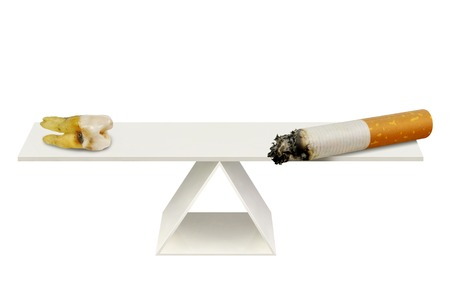 Cigarette and aching tooth on the scales on a white background