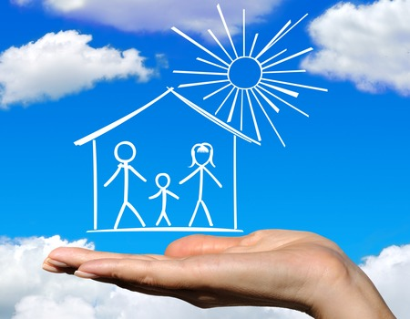 The family in the house against the blue sky and clouds Stock Photo