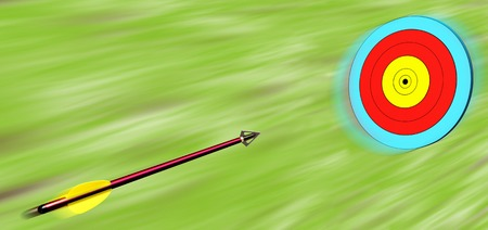 Red arrow with yellow feathers flying in a circular target Stock Photo