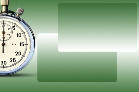 A fragment of a mechanical stopwatch on abstract green background