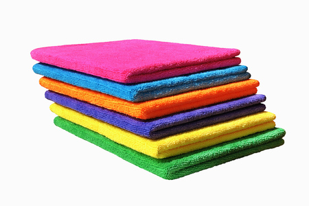 neatly: Six different colors of towels in a stack on white background Stock Photo