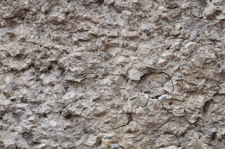 precipitation: A fragment of concrete wall destroyed by the influence of precipitation