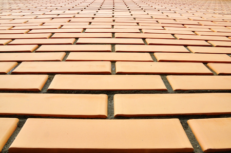 neatness: A wall made of bricks photographed with the prospect Stock Photo