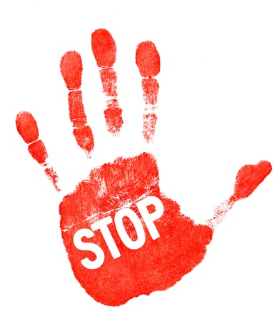 Red imprint of his hand and the word stop on white background