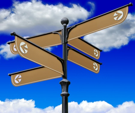 The signpost directions on a background of blue sky and clouds Stock Photo