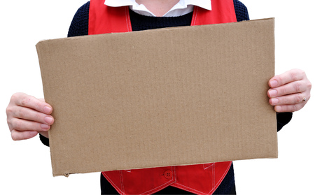 Banner of corrugated cardboard in woman hands on white background