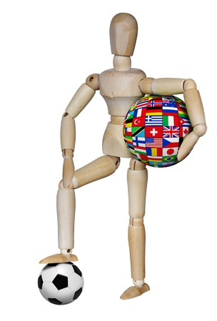 Wooden dummy with a soccer ball and the sphere of national flags on white background Stock Photo