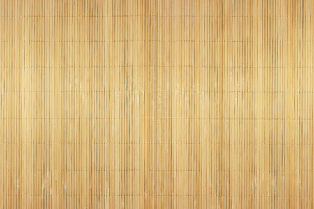 A fragment of a mat of interwoven chips of bamboo as background