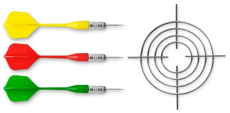 Three colored dart and the metal target on a white background Stock Photo