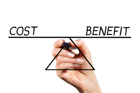 The balance of costs and benefits drawn by hand with marker on white background Stock Photo