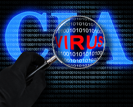 The virus in the magnifying glass on the background of the computer code and logo of CIA Stock Photo