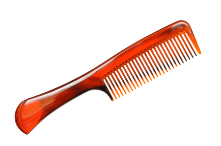 Hair comb from the brown plastic on white background Stock Photo