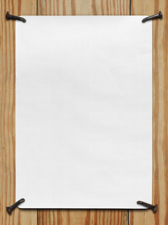 A clean sheet of cardboard nailed to a wooden wall Stock Photo