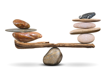 The balance of pyramids of stones on a white background