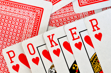 combination: The combination of the playing cards made up the word poker Stock Photo