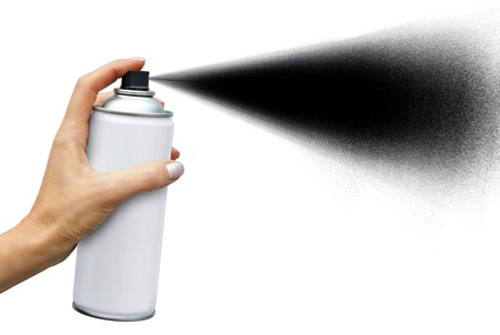 Black jet dispersion from an aerosol can in female hand on white background 版權商用圖片 - 87398618