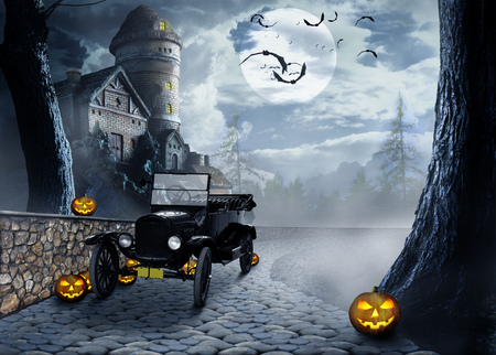 Vintage car among the pumpkins on the cobblestone path amid dismal rural buildings in the foggy moonlit night on Halloween