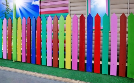 A fragment of the fence, painted with paints of various colors and shades