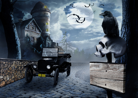 Black crow on a roadside signpost with a human skull on a background of vintage car and stone buildings in sinister moonlight night