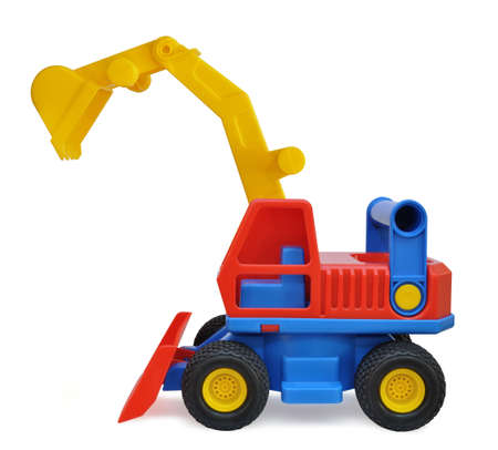 Children's toy excavator made of colored plastic on a white background 스톡 콘텐츠