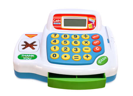 Toy cash register made of colored plastic on a white background