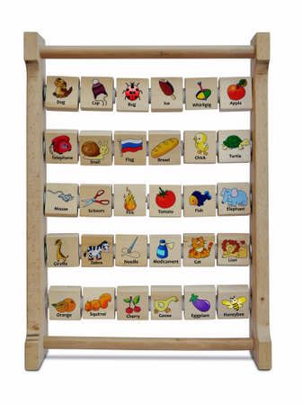 Children's educational toy with colored applications on wooden cubes on a white background