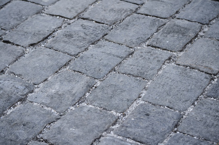 pavers: Stone pavers as gray rectangles in the town square. Stock Photo