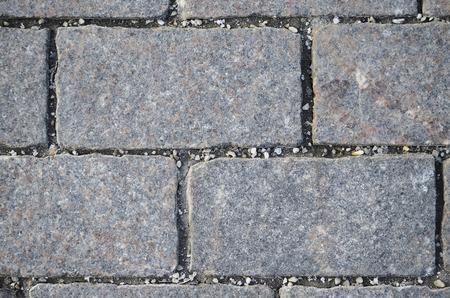 adoquines: Adoquines de piedra como rect�ngulos grises en la plaza del pueblo.