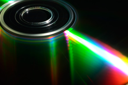 iridescent: Iridescent reflections on the surface of the laser disk. Close up view. Stock Photo