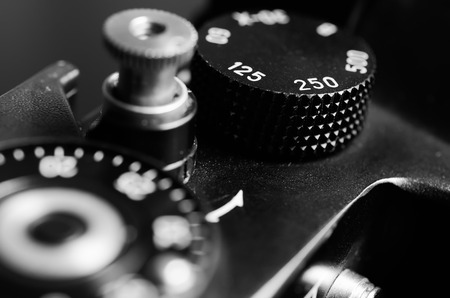 macro film: Old film DSLR camera. The wheel of choice shutter and shutter button. Close up view. Macro. Selective focus. Vintage photo. Toning.
