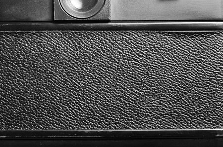 macro film: Back part of the film dslr camera with a cover the covered skin. Close-up view. Macro. Vintage photo. Toning.