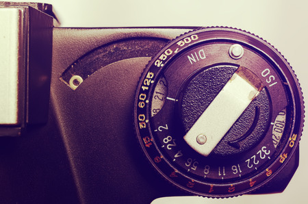 macro film: Old film DSLR camera. The dial sensitivity of the film. Rewinding the film. Index of the exposure meter. Close up view. Macro. Top view. Selective focus. Vintage photo. Toning.