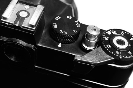 macro film: Old film DSLR camera. The wheel of choice shutter, frame counter and shutter button. Close up view. Macro. Selective focus. Vintage photo. Toning.