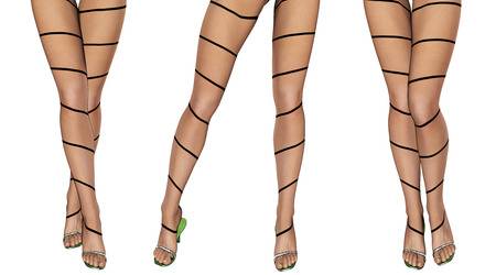 legs stockings: Sexy slim female legs in dark stockings. Conceptual fashion art. Patterned pantyhose. 3D render. Stock Photo