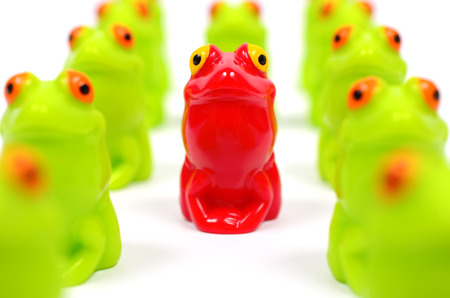 other: Small plastic toy frogs. One red and the other green Stock Photo