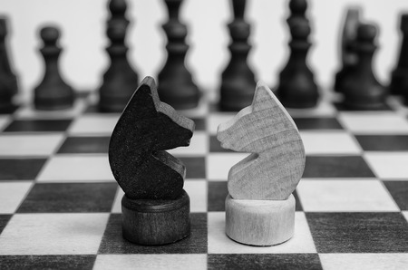 confrontation: Two knight on a chessboard. Confrontation.