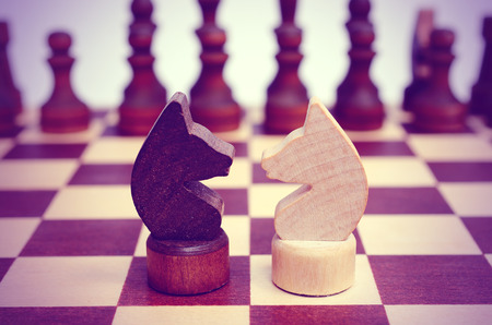 Two knight on a chessboard. Confrontation.