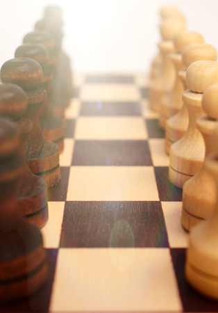 pawns: Troop pawns on a chessboard.