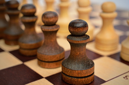 troop: Troop pawns on a chessboard.