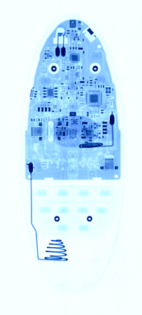 TV remote control under X-rays in blue tones on white background. Visibility through. Image was obtained with real X-ray machine.