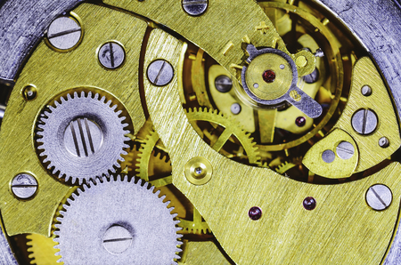 Gears old mechanical watches. Pendulum, cogs under the hood. Close up view, selective focus.Vintage tone Stockfoto