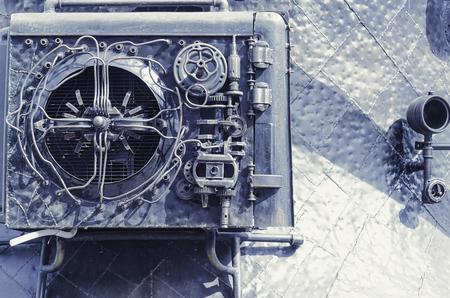 スチームパンクスタイル。金属機構。ギア、パイプ、リベット、ボルト、パッチ。アートコンディショナー。 写真素材