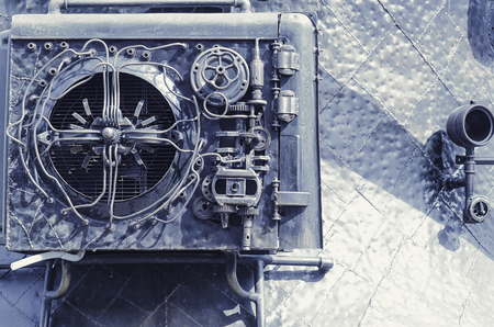 Steampunk style. Metal mechanisms. Gears, pipes, rivets, bolts, patches. Art conditioner.