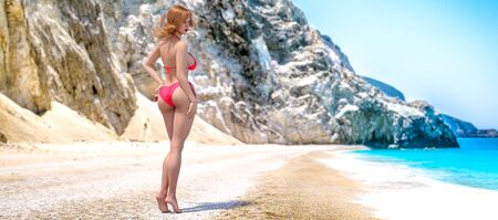 3D beautiful woman red swimsuit bikini on sea beach.Rocky coast clear white sand.Summer rest.Blue ocean background.Sunny day.Conceptual fashion art.Seductive candid pose.Render illustration.