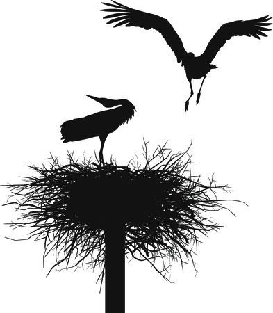 Sagome di due cicogne a nidificare
