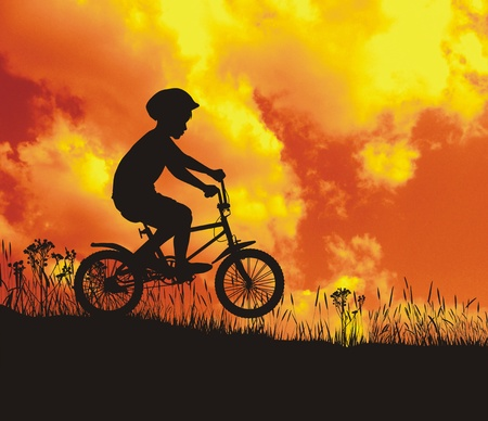 Silhouette of a boy in the background with a red sky Stock Photo - 9072807