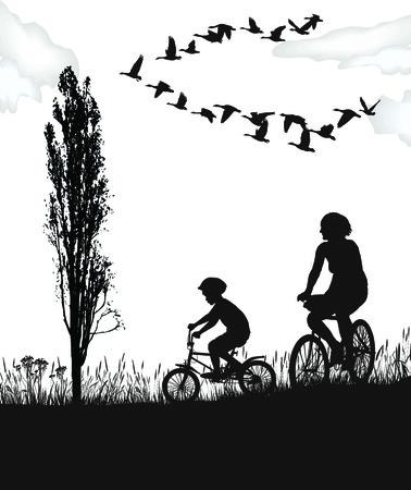 図少年と秋の自然の中で自転車の女性