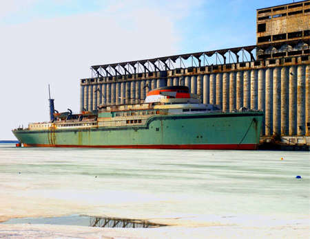 old ship next to an old building on frozen lake erie 5 miles south of buffalo ny Stock Photo
