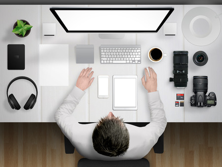 photographer and desk mockup scene with devices from top Фото со стока