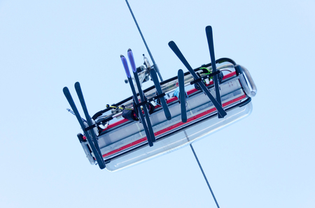 ski lift: ski lift with skiers from bottom